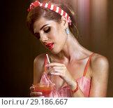 Купить «Martini glass flirt. Fun pin up girl drink alcohol cocktail.», фото № 29186667, снято 21 октября 2018 г. (c) Gennadiy Poznyakov / Фотобанк Лори