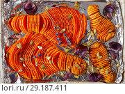 Купить «close-up of sliced pumpkins baked in an oven», фото № 29187411, снято 6 октября 2018 г. (c) Oksana Zh / Фотобанк Лори