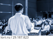 Купить «Public speaker giving talk at Business Event.», фото № 29187823, снято 3 июля 2014 г. (c) Matej Kastelic / Фотобанк Лори