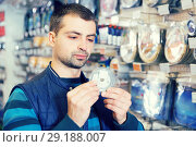 Купить «fisherman choosing fishing accessories», фото № 29188007, снято 16 января 2018 г. (c) Яков Филимонов / Фотобанк Лори