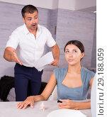Купить «Husband scolding wife painting nails», фото № 29188059, снято 17 июля 2018 г. (c) Яков Филимонов / Фотобанк Лори