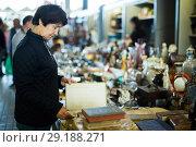 Купить «Adult woman is looking antiquariat», фото № 29188271, снято 23 октября 2017 г. (c) Яков Филимонов / Фотобанк Лори