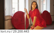Sexy girl in red dress training her pole dance. Стоковое видео, видеограф Константин Шишкин / Фотобанк Лори