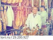Купить «Farm workers checking condition of jamon», фото № 29200927, снято 15 сентября 2019 г. (c) Яков Филимонов / Фотобанк Лори