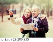 Купить «Mature spouses with paper map», фото № 29200935, снято 17 октября 2018 г. (c) Яков Филимонов / Фотобанк Лори