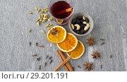 Купить «hot mulled wine, orange slices, raisins and spices», видеоролик № 29201191, снято 7 октября 2018 г. (c) Syda Productions / Фотобанк Лори