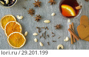 Купить «hot mulled wine, orange slices, raisins and spices», видеоролик № 29201199, снято 7 октября 2018 г. (c) Syda Productions / Фотобанк Лори
