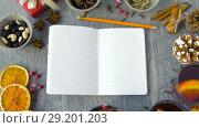 Купить «notebook, hot mulled wine and aromatic spices», видеоролик № 29201203, снято 7 октября 2018 г. (c) Syda Productions / Фотобанк Лори