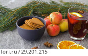 Купить «glass of hot mulled wine, cookies, apples and fir», видеоролик № 29201215, снято 7 октября 2018 г. (c) Syda Productions / Фотобанк Лори
