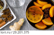 Купить «pot with hot mulled wine, orange slices and spices», видеоролик № 29201375, снято 7 октября 2018 г. (c) Syda Productions / Фотобанк Лори