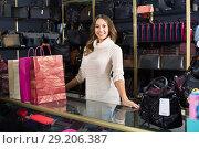 Купить «Portrait of woman selling wallets and purses», фото № 29206387, снято 21 октября 2018 г. (c) Яков Филимонов / Фотобанк Лори