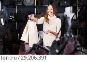 polite friendly shopgirl in haberdashery shop. Стоковое фото, фотограф Яков Филимонов / Фотобанк Лори