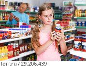 Купить «Tweenage girl buying food in supermarket», фото № 29206439, снято 4 июля 2018 г. (c) Яков Филимонов / Фотобанк Лори