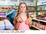 Купить «Tweenage girl buying food in supermarket», фото № 29206447, снято 4 июля 2018 г. (c) Яков Филимонов / Фотобанк Лори