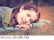 Купить «portrait of young female while lying in spring green garden», фото № 29206743, снято 18 апреля 2017 г. (c) Яков Филимонов / Фотобанк Лори