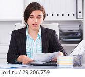 Купить «Office manager woman is reading documents about the transaction», фото № 29206759, снято 21 мая 2017 г. (c) Яков Филимонов / Фотобанк Лори