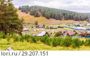 Купить «Ural village among the mountain peaks and taiga.», фото № 29207151, снято 5 сентября 2017 г. (c) Акиньшин Владимир / Фотобанк Лори