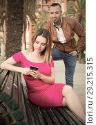 Купить «Young woman is inaccessibility when man is playful talking with her», фото № 29215315, снято 18 октября 2017 г. (c) Яков Филимонов / Фотобанк Лори