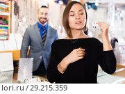 Купить «Buyer woman choosing earrings in jewelry store», фото № 29215359, снято 16 октября 2017 г. (c) Яков Филимонов / Фотобанк Лори