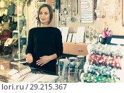 Купить «Smiling seller female showing bracelets», фото № 29215367, снято 16 октября 2017 г. (c) Яков Филимонов / Фотобанк Лори