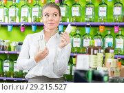 Купить «Girl choosing perfume», фото № 29215527, снято 24 апреля 2018 г. (c) Яков Филимонов / Фотобанк Лори