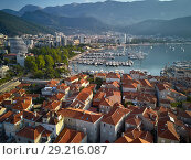 Купить «View at sea bay and town of Budva in Montenegro», фото № 29216087, снято 9 августа 2018 г. (c) Andriy Bezuglov / Фотобанк Лори