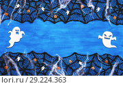 Купить «Halloween background - spider web lace, ghosts, ghosts and smiling jack decorations as symbols of Halloween on the dark blue wooden background. Halloween festive concept», фото № 29224363, снято 8 октября 2018 г. (c) Зезелина Марина / Фотобанк Лори