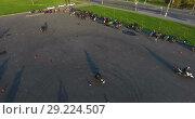 Купить «Большая группа мотоциклистов на автомобильной парковке, Стрельна», видеоролик № 29224507, снято 30 мая 2018 г. (c) Кекяляйнен Андрей / Фотобанк Лори