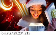 Excited Santa woman opening magical Christmas gift box with glowing patterns. Стоковое видео, агентство Wavebreak Media / Фотобанк Лори