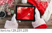 Купить «Santa using tablet with Christmas snowflakes», видеоролик № 29231235, снято 16 июня 2019 г. (c) Wavebreak Media / Фотобанк Лори