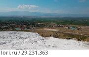 Купить «Panorama view from above on Pamukkale . Aerial view of Hierapolis Ancient Greco-Roman city in Turkey», видеоролик № 29231363, снято 21 января 2019 г. (c) Сергей Тимофеев / Фотобанк Лори