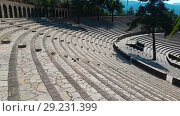 Купить «The ruins of old city debris of Turkish amphitheater. Archaeological Attraction. Ancient city Hierapolis near Marmaris in Turkey», видеоролик № 29231399, снято 19 октября 2018 г. (c) Сергей Тимофеев / Фотобанк Лори