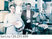 Купить «Boy and father choosing best drum», фото № 29231699, снято 29 марта 2017 г. (c) Яков Филимонов / Фотобанк Лори