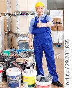 Купить «Portrait of construction worker ready for building and repair works indoors», фото № 29231835, снято 4 мая 2018 г. (c) Яков Филимонов / Фотобанк Лори