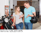 Купить «Nice man and girl is choosing modern motobikes», фото № 29231875, снято 8 мая 2018 г. (c) Яков Филимонов / Фотобанк Лори