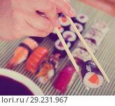 Купить «Sushi set in restaurant», фото № 29231967, снято 15 октября 2018 г. (c) Яков Филимонов / Фотобанк Лори