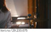 Купить «Repetition. Redhead girl plays on drums plates . Portrait. Backlights.», видеоролик № 29233075, снято 22 октября 2018 г. (c) Константин Шишкин / Фотобанк Лори