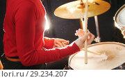 Купить «Repetition. Girl plays the drums. No face shown», видеоролик № 29234207, снято 8 июля 2020 г. (c) Константин Шишкин / Фотобанк Лори