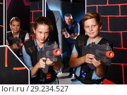 Купить «teen brother and sister with laser pistols playing laser tag with their parents», фото № 29234527, снято 3 сентября 2018 г. (c) Яков Филимонов / Фотобанк Лори