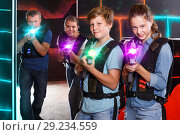Купить «interested teen brother and sister with laser pistols playing la», фото № 29234559, снято 3 сентября 2018 г. (c) Яков Филимонов / Фотобанк Лори
