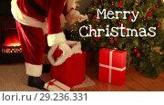 Купить «Merry Christmas text and Santa giving gifts», видеоролик № 29236331, снято 2 октября 2018 г. (c) Wavebreak Media / Фотобанк Лори