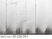 Купить «Gray industrial metal wall with rivets pattern», фото № 29236551, снято 7 июня 2018 г. (c) EugeneSergeev / Фотобанк Лори