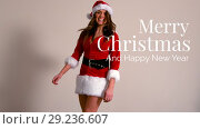 Купить «Merry Christmas text and Santa dressed beautiful woman», видеоролик № 29236607, снято 17 июня 2019 г. (c) Wavebreak Media / Фотобанк Лори