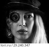 Купить «Steampunk girl portrait on black. Monocular lens», фото № 29240347, снято 13 апреля 2017 г. (c) katalinks / Фотобанк Лори