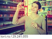 Купить «Adult customer searching for reliable lipstick», фото № 29241055, снято 21 февраля 2017 г. (c) Яков Филимонов / Фотобанк Лори