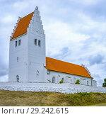 Купить «Exterior view of Fanefjord Church, Moen Island, Denmark, Scandinavia, Europe. Aussenansicht der Fanefjordkirche, Insel Mön, Dänemark, Skandinavien, Europa.», фото № 29242615, снято 15 августа 2018 г. (c) age Fotostock / Фотобанк Лори