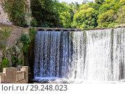 Купить «Искусственный водопад на реке Псырцха. Абхазия», фото № 29248023, снято 19 июня 2018 г. (c) Евгений Ткачёв / Фотобанк Лори