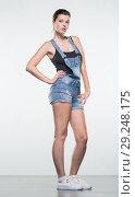 Купить «Young woman in shorts», фото № 29248175, снято 10 августа 2018 г. (c) Типляшина Евгения / Фотобанк Лори