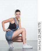 Купить «Young woman in shorts», фото № 29248179, снято 10 августа 2018 г. (c) Типляшина Евгения / Фотобанк Лори