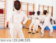 Купить «Young female in mask with foil at fencing workout», фото № 29248535, снято 11 июля 2018 г. (c) Яков Филимонов / Фотобанк Лори